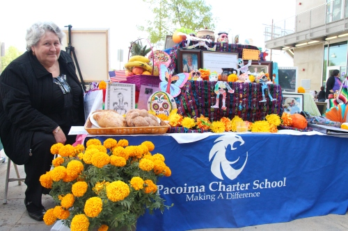 Director of the Parent Center at Pacoima Charter School Eva Torres sits next to the altar she built in honor of Marsha Finch and Mr. Snader, two Pacoima Charter teachers who recently died of cancer.