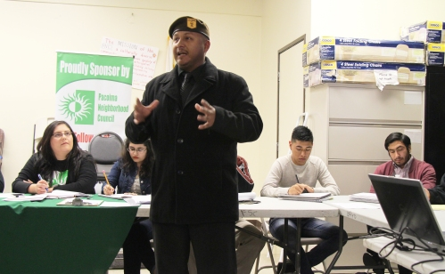 A member of the Brown Berets, whom have headquarters in Pacoima, addresses the public at the Pacoima Neighborhood Council meeting Jan. 21, 2015.