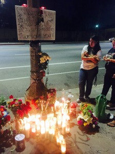 Community members stopped by the memorial to leave flowers and candles for the 15-year-old killed Monday morning.